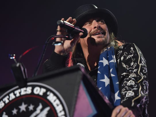 "Kid Rock gives a speech behind a ""United States of"