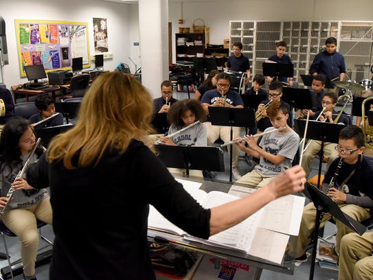 Instrumental music teacher Nancy Horowitz leads students in the fine and performing arts class on Thursday.