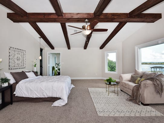 3693 Mackey Cove, the master bedroom with exposed beams