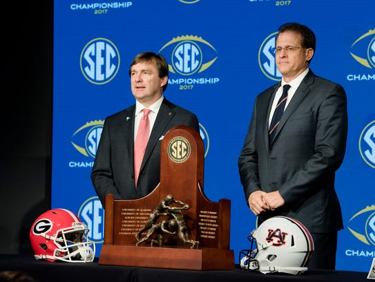 Georgia head coach Kirby Smart, left, and Auburn head
