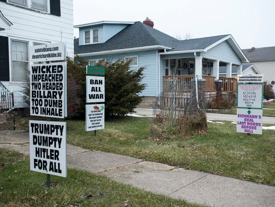 Signs displaying a property owner's stance on several
