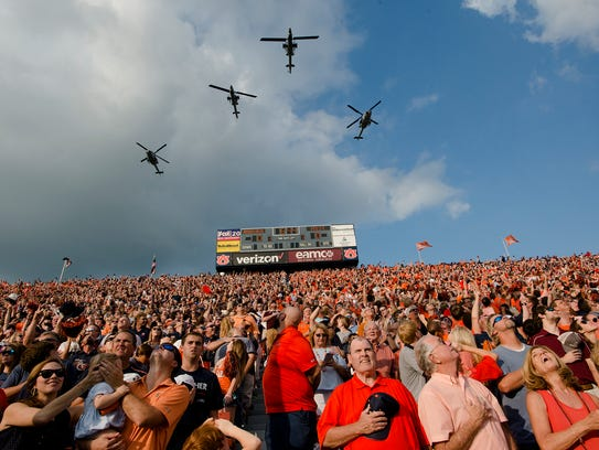Helicopters fly in before the NCAA football game between