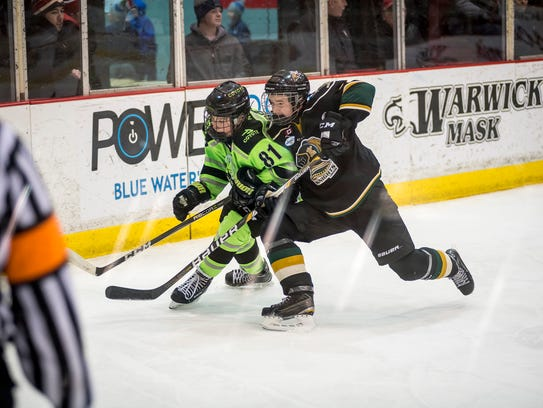 London Jr. Knights' Matthew Dunn runs into Chicago