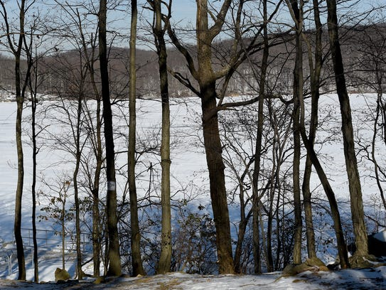 Splitrock Reservoir as seen through the trees in the