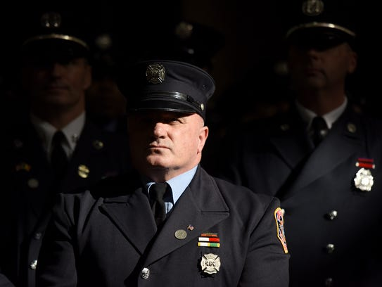 Paterson firefighter Michael Gallo and members of the