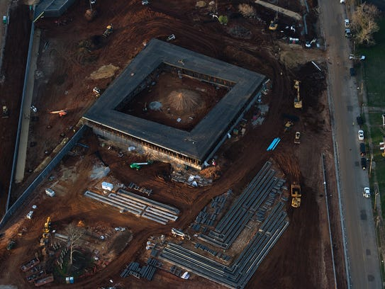 Construction crews work on the National Memorial for