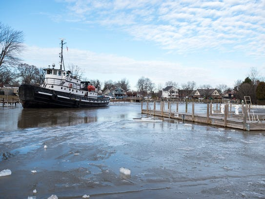 The Manitou breaks ice in the St. Clair Harbor Feb.