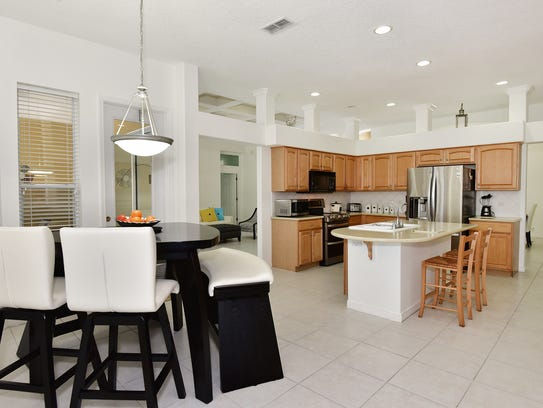 1170 Grand Pointe Drive, the open kitchen and casual