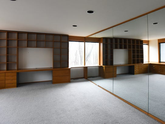 The office area in a modern white two-story in White