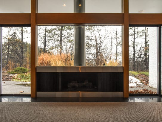 A fireplace and picture window in the dining area of