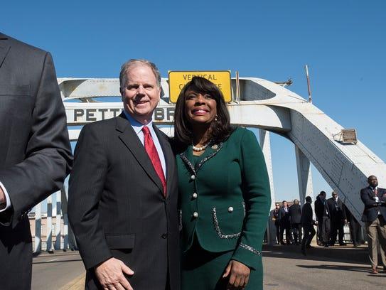 Senator Doug Jones stands with Congresswoman Terri