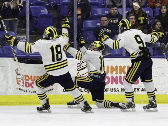 Jake Behnke (center) celebrates one of his two goals