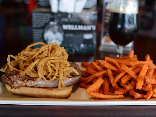 The steak sandwich with sweet potato fries at Wellman's.