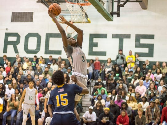 New Haven's Ashton Sherrell (3) jumps for a layup during