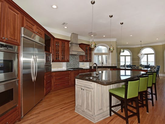 23 East Galvez Court, the open kitchen with bar seating.