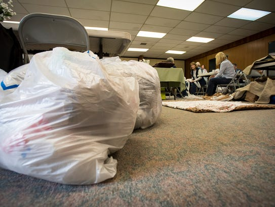 Plastic shopping bags wait to be turned into mats for