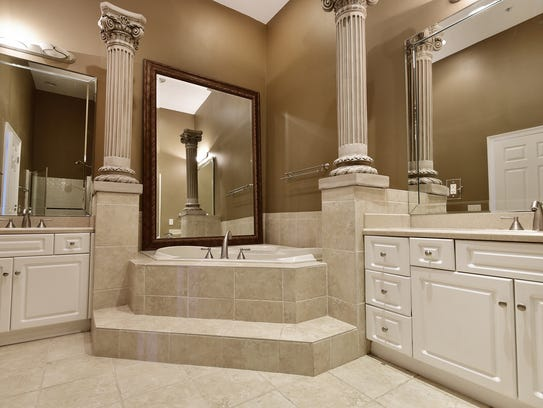 13840 River Road #302, the spa-like master bath with
