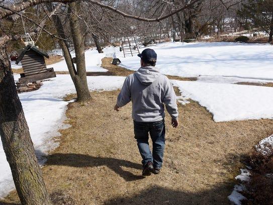 Bill Davison walks to the Mississippi River shoreline