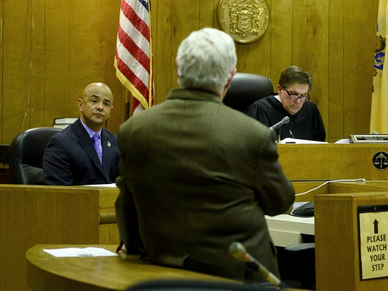 Alex Cruz answers questions from his attorney Stephen