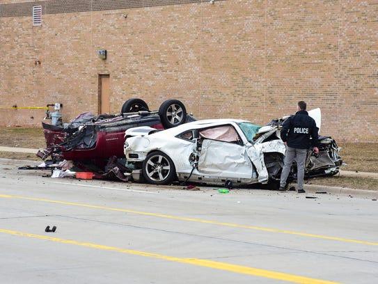 Vehicles sit damaged following a crash at Dove and