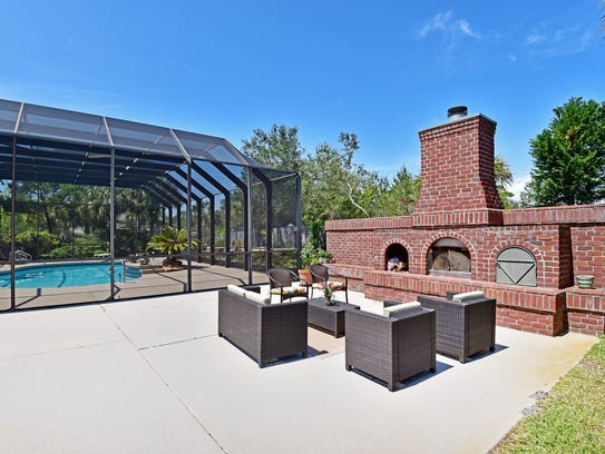 1444 West Shores Boulevard, the outdoor fireplace is