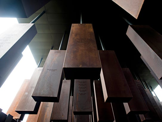 Monuments to lynching victims, designated by county from around the U.S., fill the National Memorial for Peace and Justice, which opened Thursday in Montgomery, Ala.