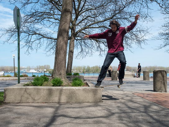 Cody Cepeda does a nose grind with his skateboard on