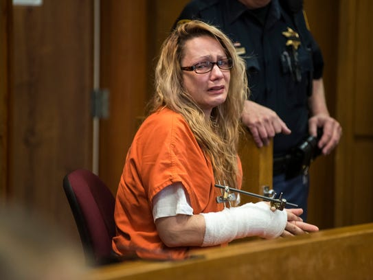 Theresa Marie Gafken waits in the jury box inside Judge