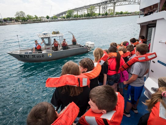 Belle River fifth-graders line the docks of the Huron