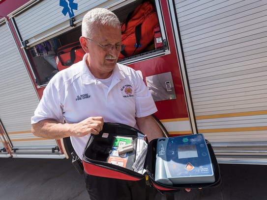 Clay Fire Chief George Rose shows an outdated defibrilator