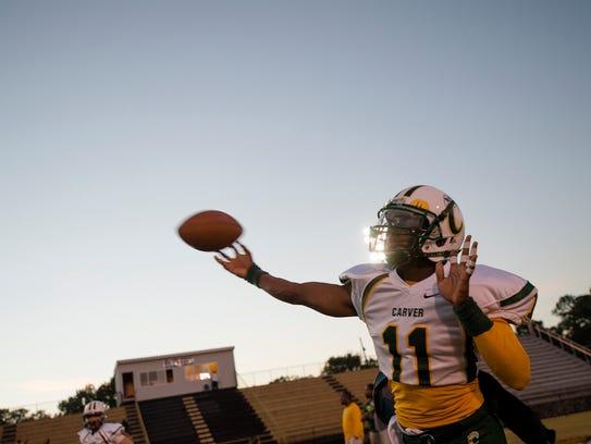 G.W. Carver quarterback Michael Mckenney throws a pass