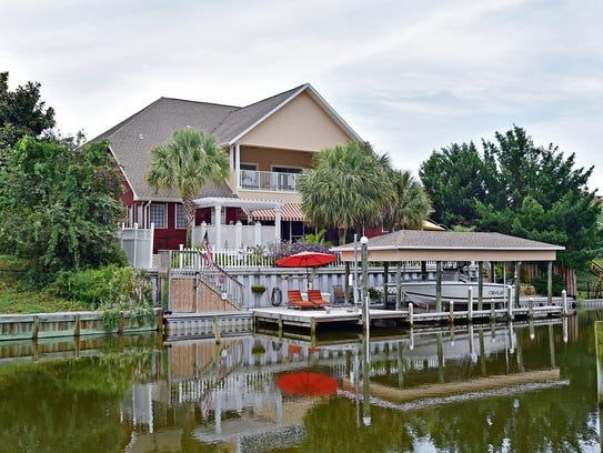 home of the week sept 23rd gulf breeze home is canal front entertaining ready. Black Bedroom Furniture Sets. Home Design Ideas