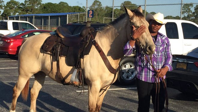 Yoenis Cespedes and friend arrive at spring training on Tuesday.