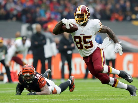 FILE - In this Oct. 30, 2016 photo, Washington Redskins tight end Vernon Davis (85) runs with the ball during an NFL Football game between Cincinnati Bengals and Washington Redskins at Wembley Stadium in London. After the 49ers and Broncos didn't want him, tight end Vernon Davis is enjoying a career renaissance with the Redskins. At 32 and in his 11th NFL season, the Maryland product is proving he still has speed to burn and ability 'left in the tank.   (AP Photo/Tim Ireland)