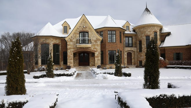 Chateau de Vin, a 7,096 square foot single family home is wrapped in brick and limestone. The house's front face is 200 feet wide. Depending on how you count, it has roughly 15 roof peaks. A tall stone turret wrapscircular stairs inside.