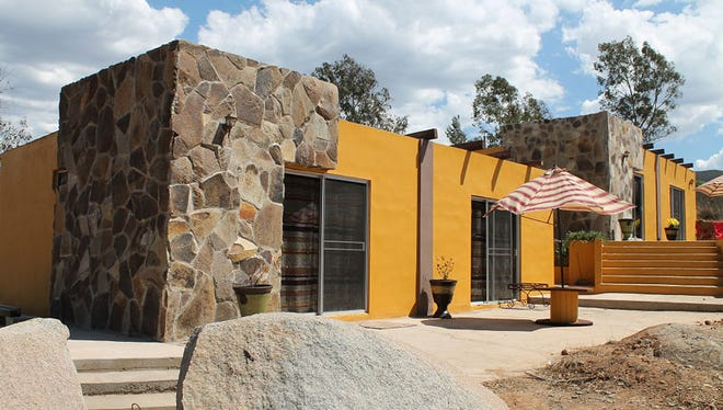 """Mexico's """"three for one"""" matching funding program helps a group of immigrants in Phoenix build vacation villas to help create tourism jobs back in their hometown."""