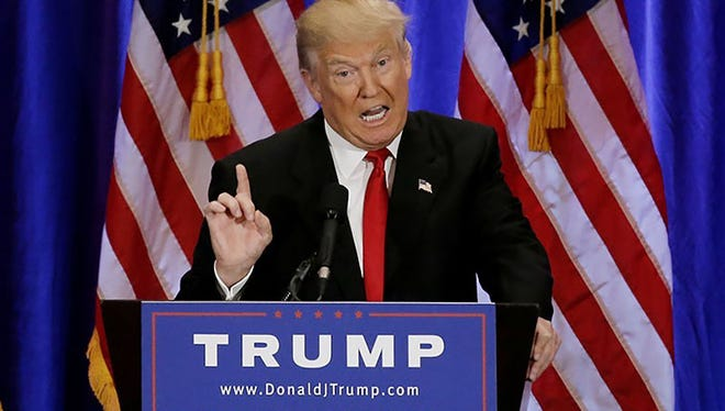 Republican presidential candidate Donald Trump gives a speech during a campaign event at the Trump Soho Hotel in New York City on June 22.