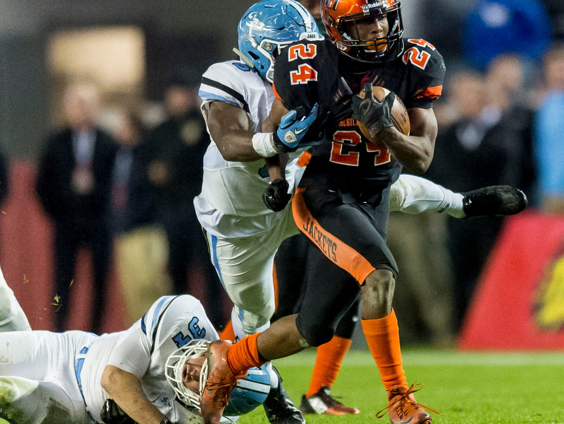 McGill-Toolen's Terrell Kennedy sheds two tacklers on the way to a 54-yard touchdowns in the second quarter of the Yellow Jackets' 14-12 win over Spain Park for the 7A championship Wednesday.