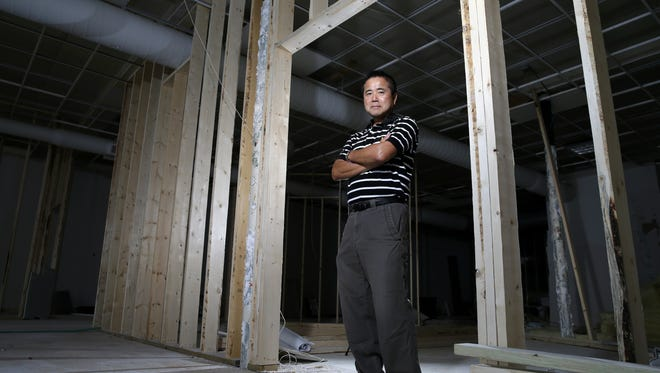 Hiro Nakashima stands in what will become his new restaurant on College Avenue in Appleton.