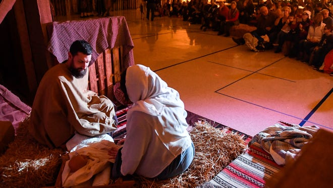 Ryan and Chelsea England portray Joseph and Mary as the Newburgh First Christian Church presents a theatrical nativity as part of their Christmas festival Saturday, December 17, 2016.
