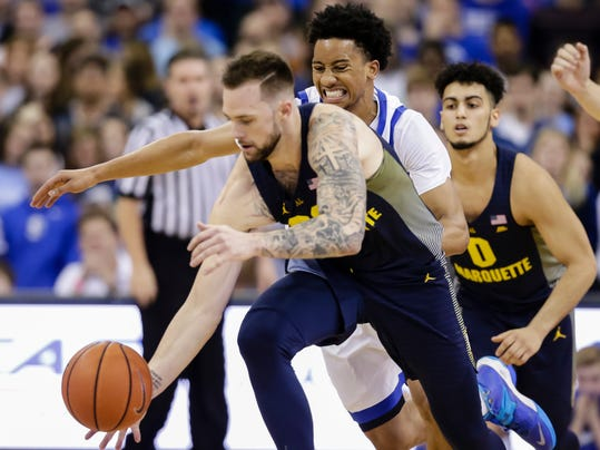 Marquette's Katin Reinhardt, front, steals the ball from Creighton's Davion Mintz, center, with Markus Howard (0) behind, during the first half of an NCAA college basketball game in Omaha, Neb., Saturday, Jan. 21, 2017. (AP Photo/Nati Harnik)