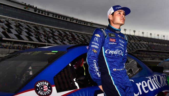 Kyle Larson, driver of the No. 42 Credit One Bank Chevrolet, stands on the grid during qualifying for the Monster Energy NASCAR Cup Series Coke Zero Sugar 400 at Daytona International Speedway on Friday in Daytona Beach.
