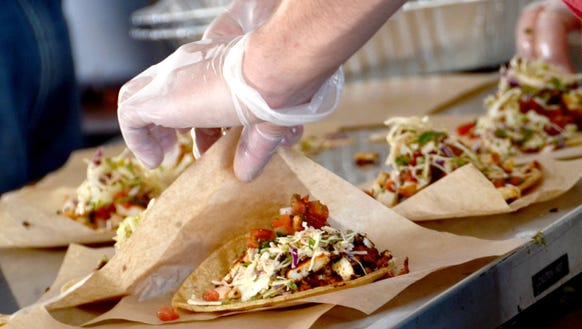 Tacos cost one token at The Taco Festival.