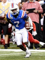 Louisiana Tech safety Xavier Woods (7) returns an interception
