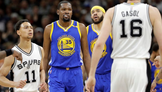 Bryn Forbes, left, scored eight points in 24 minutes in Game 4 of the Western Conference finals against Kevin Durant (35) and the Golden State Warriors.