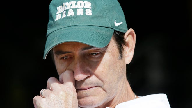 FILE - In this Dec. 5, 2015, file photo, Baylor head coach Art Briles gets emotional in the tunnel after his senior players were introduced before an NCAA college football game against Texas, in Waco, Texas. The NCAA board of governors has adopted a policy that requires sexual violence education for all college athletes, coaches and athletics administrators. Campus leaders such as athletic directors and school presidents will be required to attest that athletes, coaches and administrators have been educated on sexual violence each year. The move follows a number of high-profile assault cases, including Baylor.(AP Photo/LM Otero, File) ORG XMIT: NY184