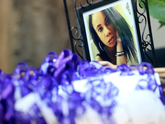 A photo of Breanna Wood is placed at the entrance of the Corpus Christi Christian Fellowship during her memorial service on Saturday, Jan. 14, 2017, in Corpus Christi.