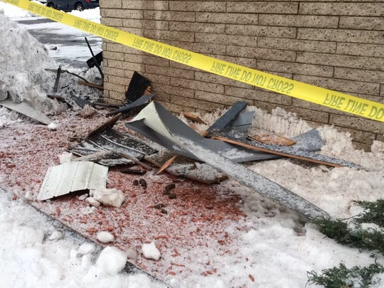 Debris lies on the ground outside a Green Bay apartment building thast was heavily damaged by fire on Sunday, Jan. 3, 2016.
