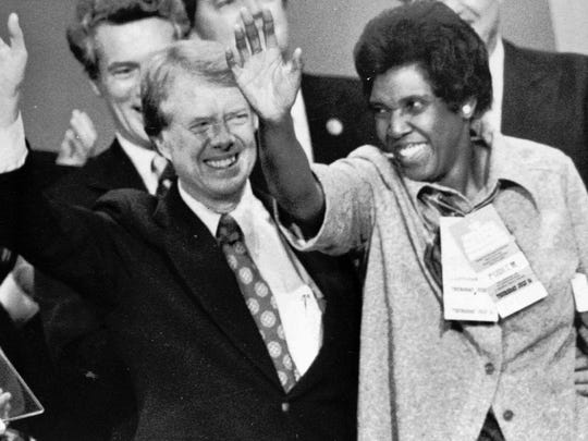 Rep. Barbara Jordan, D-Texas, joins Carter at the podium