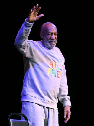 Comedian Bill Cosby walks on stage for his performance in Melbourne, Fla., on Nov. 21.